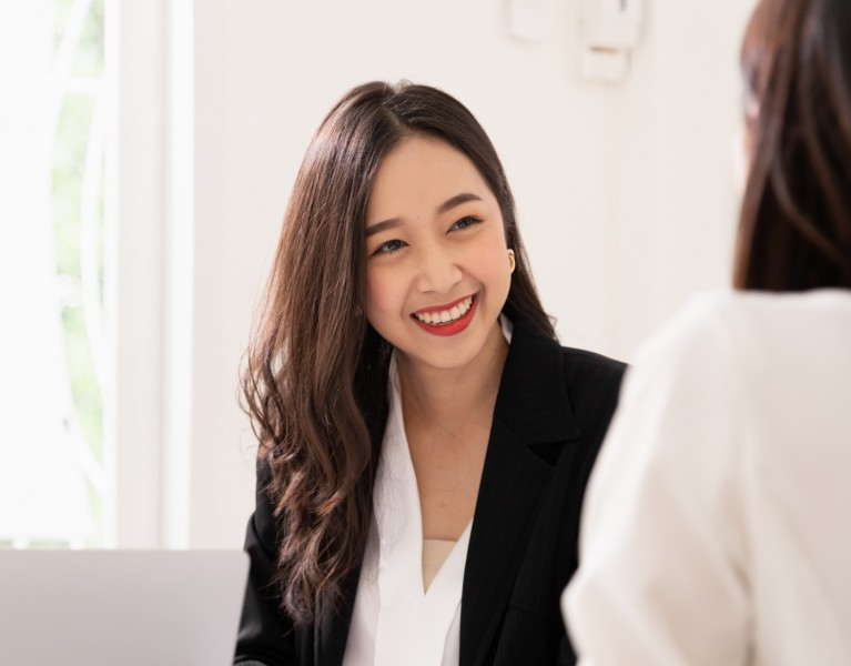 business woman talking to another person