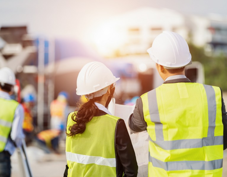 Construction Safety Officers talking on a site