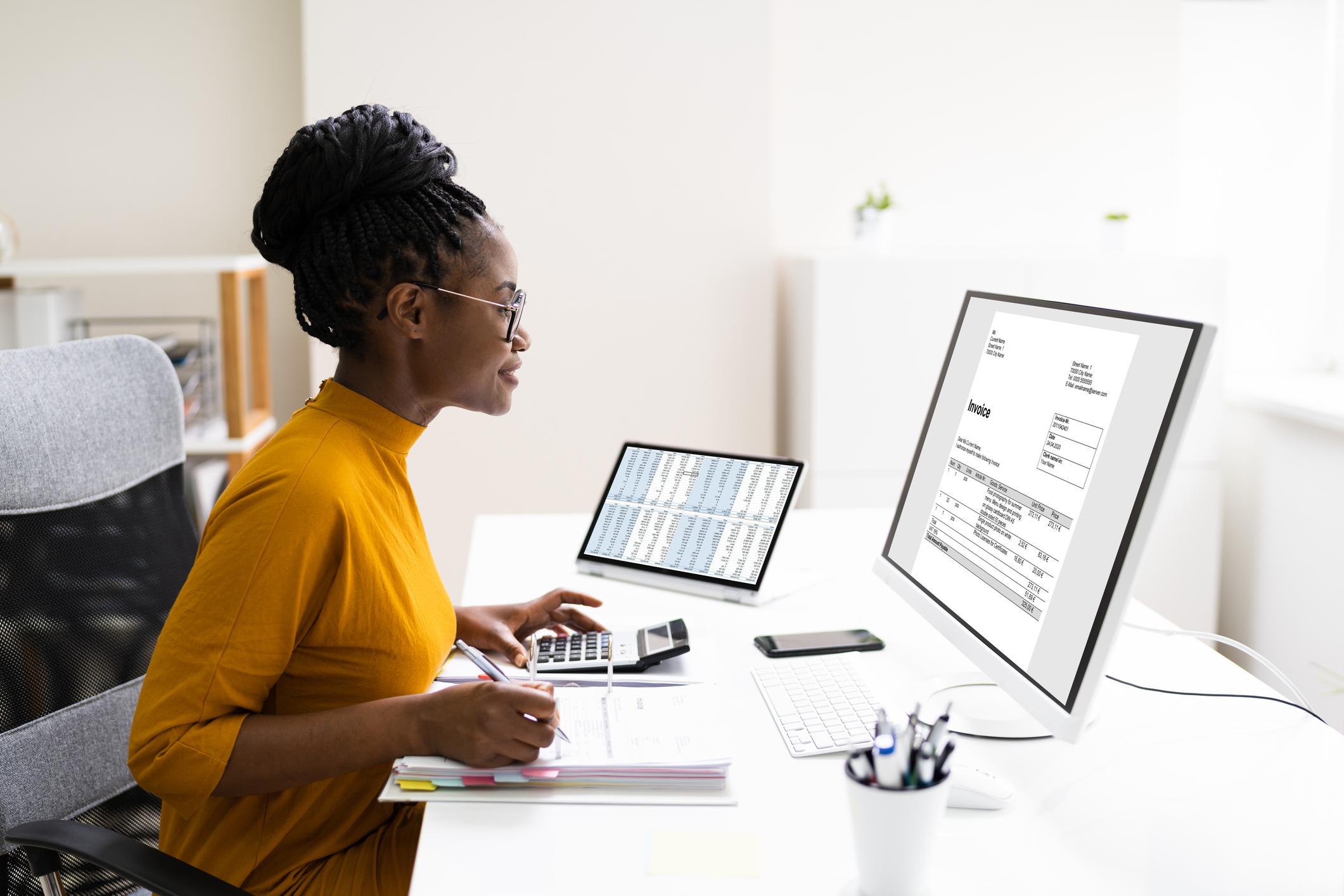 Accounting Clerk at a computer